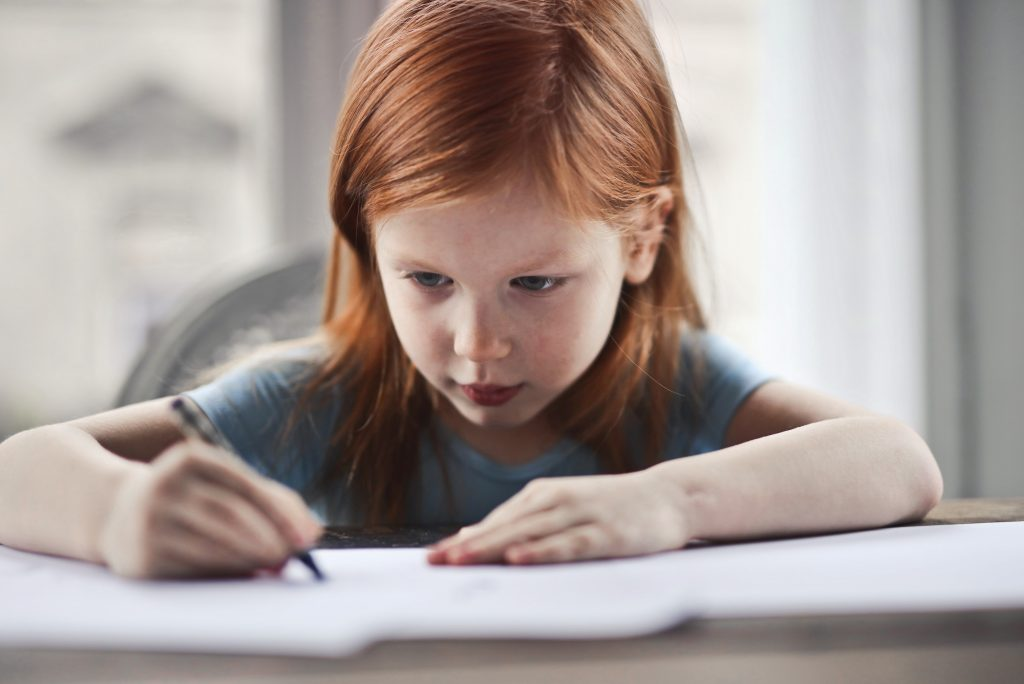 picture of girl writing with pencil