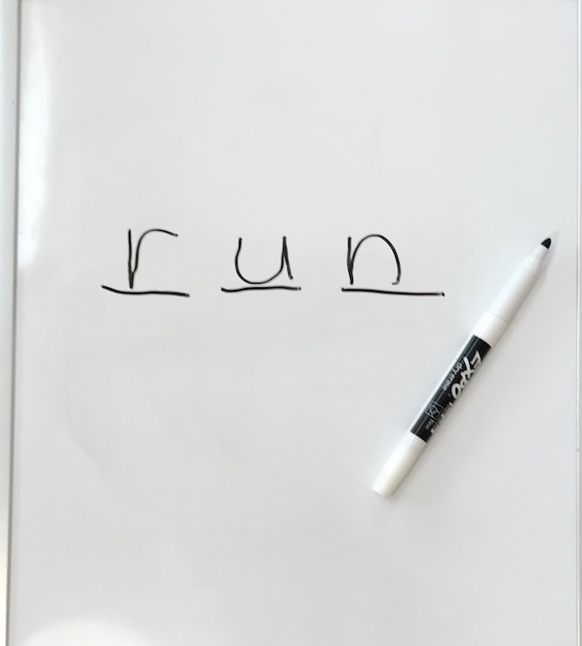 picture of white board and marker with the word run