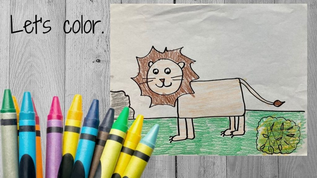 crayons and a drawing of a lion