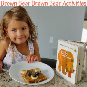 Picture of Brown Bear Brown Bear book with girl eating a brown bear snack