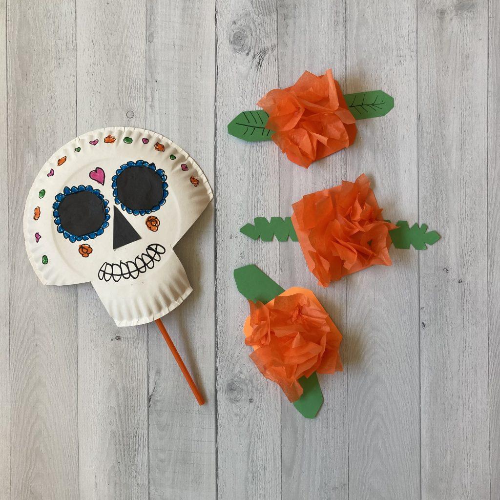skeleton mask and tissue paper marigolds